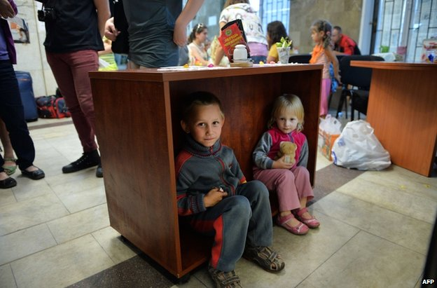 Children playing in the administrative headquarters of the self-proclaimed Donetsk People's Republic in Donetsk, 12 June