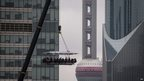 Diners are suspended from a crane as they enjoy a meal
