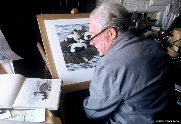Charles Tunnicliffe at work in his home at Malltraeth