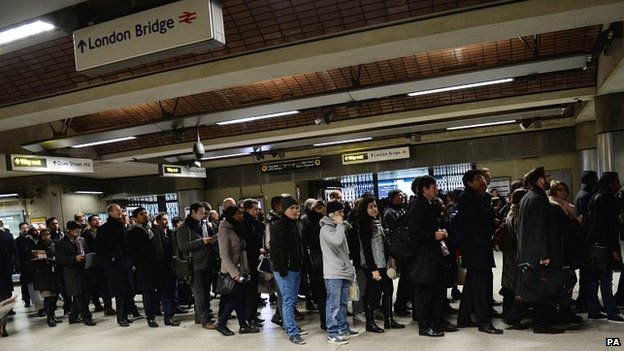 Commuters queuing at London Bridge station