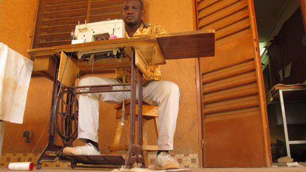 Tailor Oscar Dao working on his treadle machine, Burkina Faso