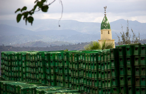 Beer crates in the foreground, a mosque in the background