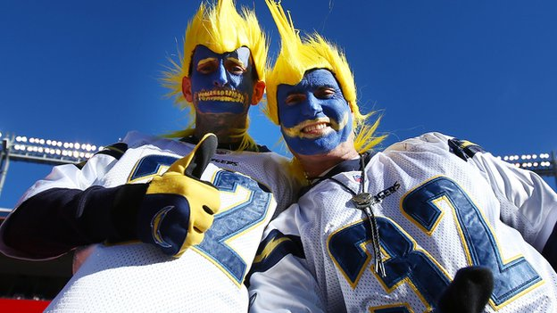 Two San Diego Chargers fans dress up for a game.