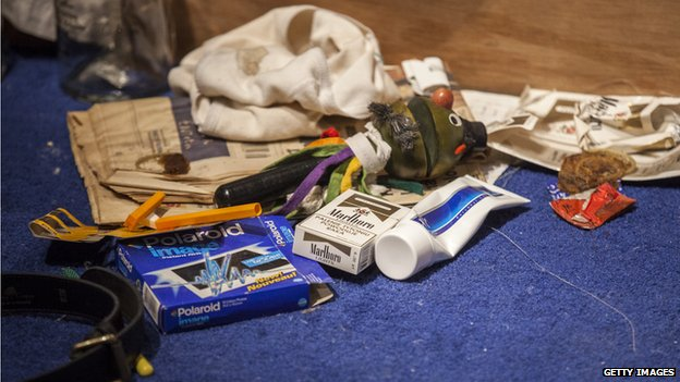 The work includes empty vodka bottles, cigarette packets, discarded condoms and soiled underwear