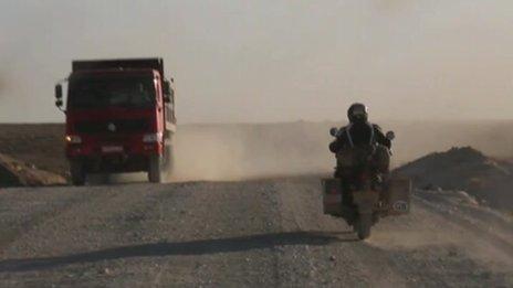 Chris Short riding through desert