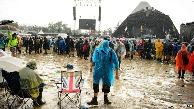 Festivalgoers face up to the heavy rain at Glastonbury