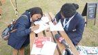 Safara and Imanuella from Erith School make notes