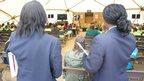 School reporters from Erith School watch Larry Lamb talk to primary school pupils
