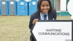 Imanuella leads the way to the War Time Communications tent