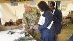 Captain Steve Slayney from The Royal Signals shows the girls how to use Morse code.