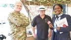 Imanuella with Captain Steve Slayney and Adam Forty from the Royal Signals museum