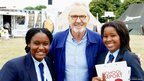 Imanuella and Safara get to pose for a photo with Larry Lamb.