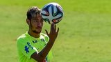 Brazil's Neymar spinning a football on his fingers during training in Belo Horizonte