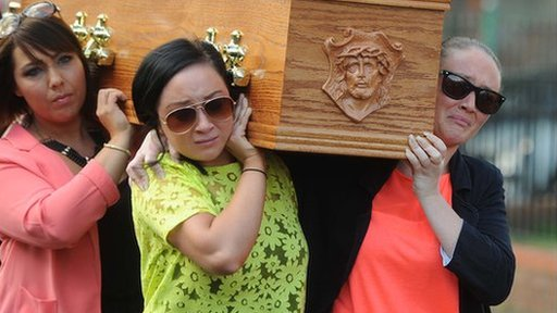 Gerry Conlon's coffin was carried into St Peter's Cathedral in Belfast