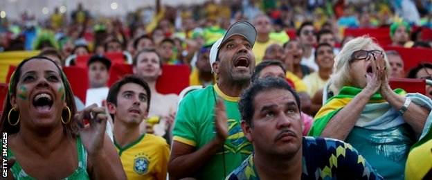 Brazil fans watch their team on a big screen