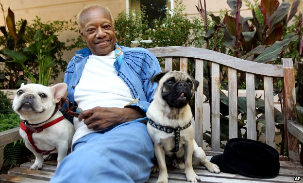Bobby Womack sits with his dogs, a French bull dog named Music, left, and a pug named Wo - 22 June 2012