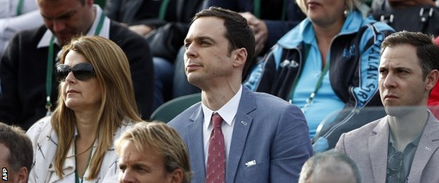 Big Bang Theory actor Jim Parsons (centre) watches Eugenie Bouchard