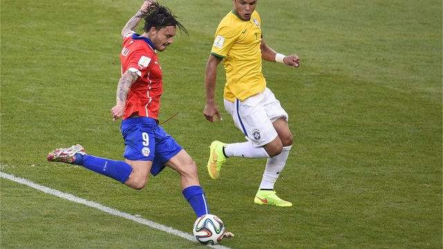Mauricio Pinilla hits the bar for Chile