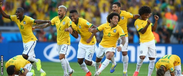 Brazil players celebrate after Gonzalo Jara misses the final penalty