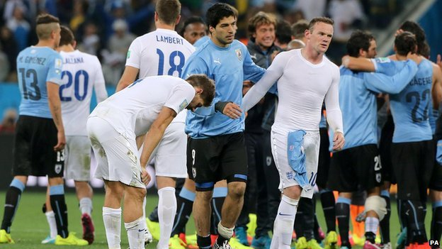 Uruguay's Luis Suarez consoles England's Wayne Rooney and Steven Gerrard after their the Group D match the Estadio do Sao Paulo, Sao Paulo, Brazil, on 19 June 2014