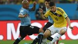 Uruguay and Colombia vie for the ball