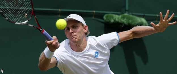 Kevin Anderson in action at Wimbledon 2014