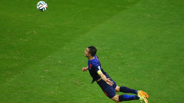 Robin Van Persie scores a header for the Netherlands against Spain