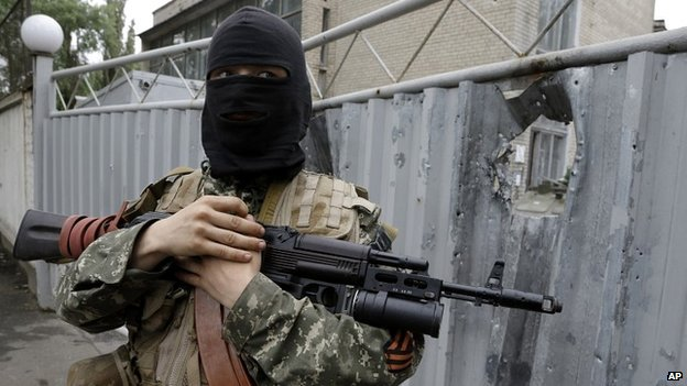 A pro-Russian fighter outside a Ukrainian military site captured by rebels in the city of Donetsk - 27 June 2014