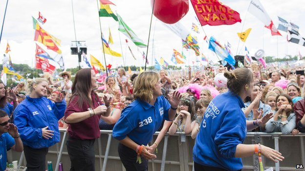Security staff dancing to Dolly Parton at Glastonbury 2014