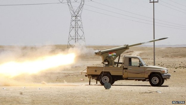 Kurdish security forces fire a missile towards Isis militants in Jalawla, Diyala province - 29 June 2014