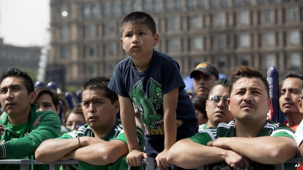 Mexican supporters watch the match at the Zocalo square