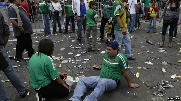 Desolate Mexican fan at the Zocalo square in Mexico City
