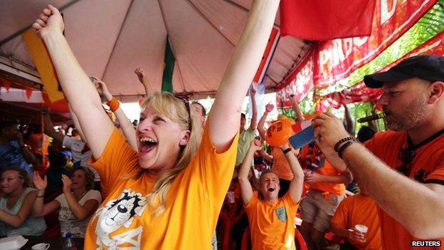 Dutch supporters celebrate victory in Surinam