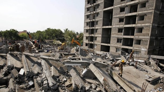 Rescue search through the rubble in Delhi. Photo: 28 June 2014