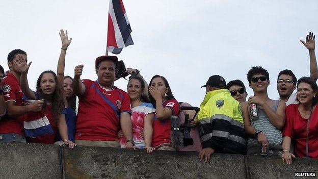Costa Rican President Luis Guillermo Solis celebrates with fans in San Jose on 29 June, 2014