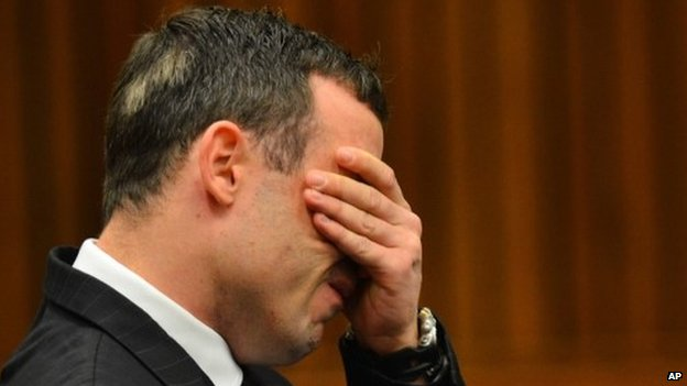 Oscar Pistorius listens to evidence in court in Pretoria, South Africa, on 30 June 2014