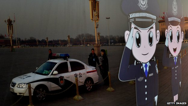 Chinese police officers reflected in bus window in Beijing