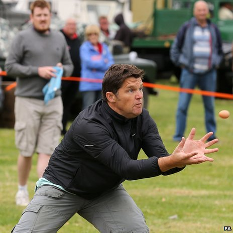 Man catching egg
