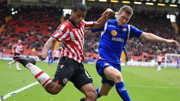 Sheffield United's Lyle Taylor gets cross over before challenge from Crewe Alexandra's Adam Dugdale
