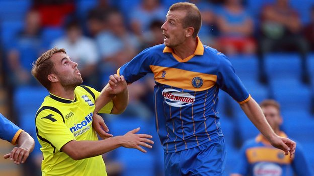 Birmingham City's Andrew Shinnie (left) challenges Shrewsbury's Luke Summerfield