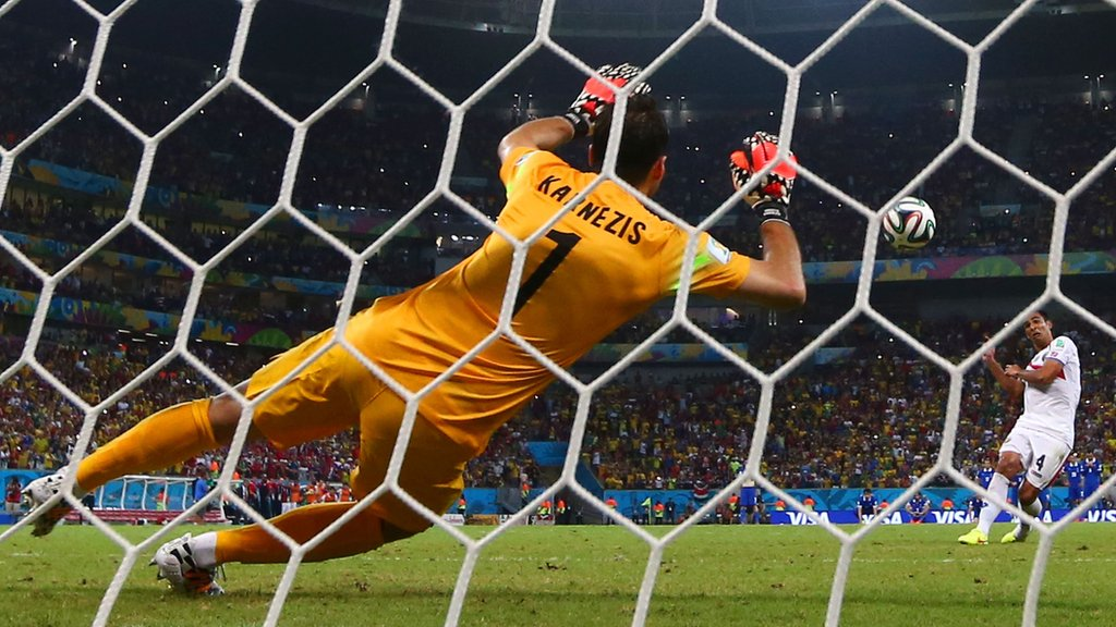 Michael Umana scores Costa Rica's final penalty in their shoot-out win over Greece
