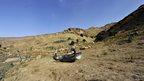 Yemeni men inspect an abandoned boat