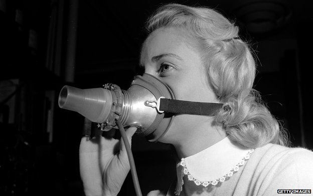 Circa 1955: A woman wears a mask as part of a research programme for hay fever sufferers. Air pressure from the lungs is converted into an electrical current which gives an 'electrical pattern' useful for determining individual responses to pollen
