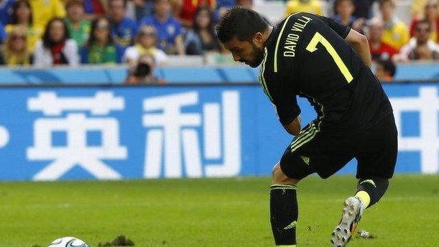 David Villa scores a back-heel against Australia