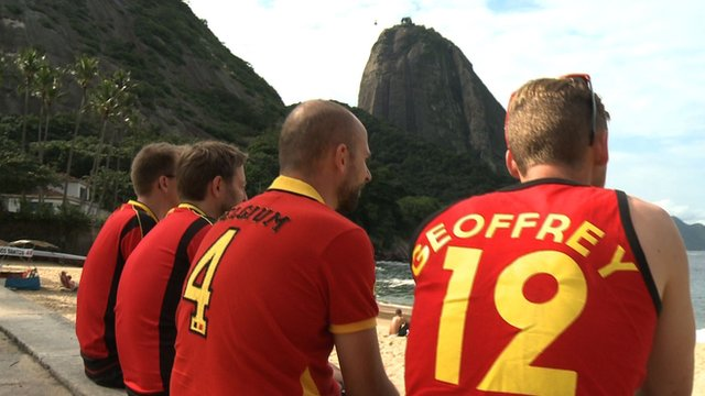 Belgium fans sit at the beach in Rio