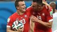 Switzerland's midfielder Xherdan Shaqiri and forward Josip Drmic (C) celebrate their victory during the Group E football match between Honduras and Switzerland at the Amazonia Arena in Manaus on 25 June 2014