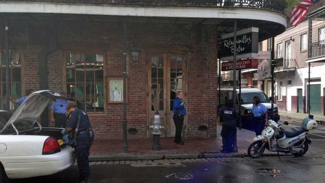Authorities continue working the scene along Bourbon Street after a shooting, early Sunday, June 29, 2014, in New Orleans