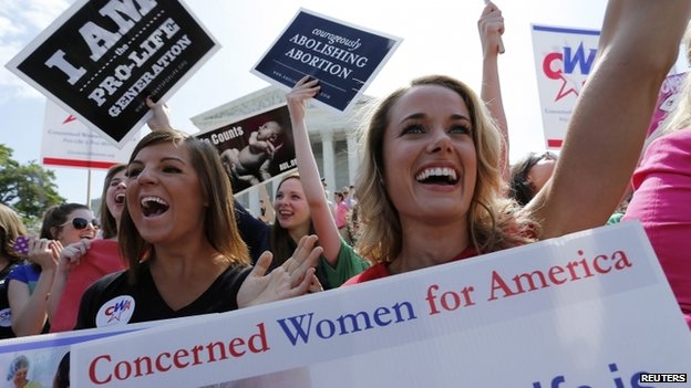 Anti-abortion demonstrators cheered as the ruling was announced outside the US Supreme Court in Washington DC on 30 June 2014