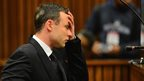 Oscar Pistorius listens to evidence in the Pretoria High Court on June 30, 2014, in Pretoria, South Africa