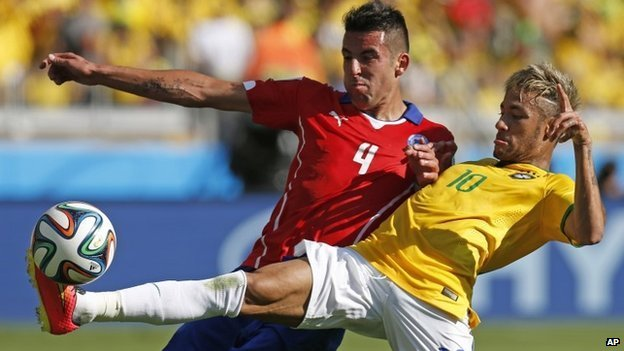 Brazil's Neymar, right, fights for the ball with Chile's Mauricio Isla during their World Cup match at Mineirao Stadium in Belo Horizonte, Brazil, on 28 June 2014